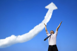 uccess businessman with business growing graph cloud